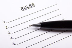 Close up of sheet of paper with rules blank and pen Stock Image