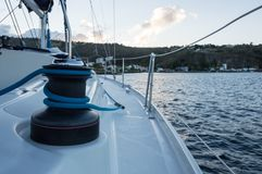 Sailing yacht sheet winch with ocean in background stock photography
