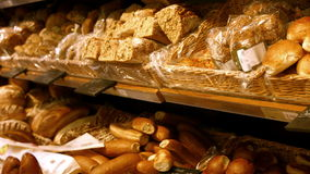 Close-up of shelves with bread. At supermarket 4k stock video footage