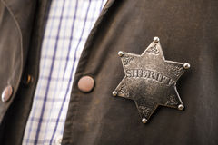 Close up of sheriff badge. When on his coat duster stock photos