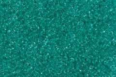 Shiny green seed beads background. Royalty Free Stock Images