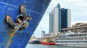 Ship`s anchor against the background of the port stock image
