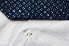 Close up of shirt and blue patterned tie Stock Photo
