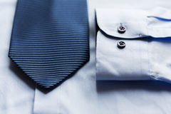 Close up of shirt and blue patterned tie Royalty Free Stock Photo