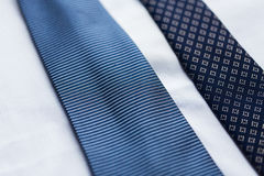 Close up of shirt and blue patterned ties Royalty Free Stock Images