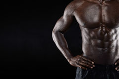 Close-up of shirtless african man with hands on hip Stock Photography