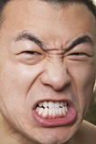 Close up of shirtless young athletic man growling Royalty Free Stock Photography