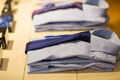 Close up of shirts with ties at clothing store Stock Photos