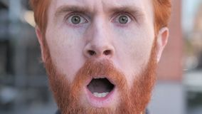 Close up of Shocked Face of Beard Young Man Face stock video footage