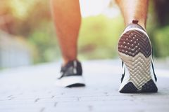 Close up shoe fitness people runner athlete running at on road stock photo