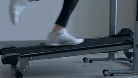 Female foots running on treadmill at home. Close up shoot - female foots running on treadmill at home stock footage