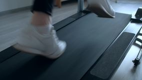 Female foots running on treadmill at home. Close up shoot - female foots running on treadmill at home stock video
