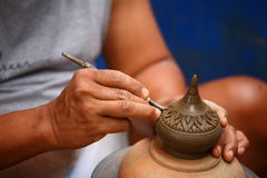Close up shoot a man making detail the pottery. Stock Images