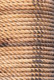 Old sailboat rope background texture. Portrait version. Close up shoot of an old sailboat rope for background and texture purposes. Portrait version stock images