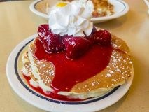 Close up shoot of traidional american breakfast. Of cream, Strawberry and pancake, photo taken at a chain restaurant, Los Angeles, California, United States Royalty Free Stock Photography
