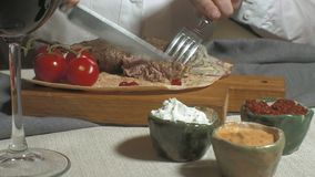 Close-up shooting: grilled meat with vegetables and various sauces stock video