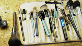 Close up shooting quality brushes for professional make-up on table stock footage