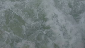 Close-up shooting water traveling by boat outdoors on fresh air. Waves with monotonous sound beating against side of ship, water moving with foam. On lake stock video footage