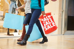Close Up Of Shoppers Carrying Bags In Mall. Walking Stock Image