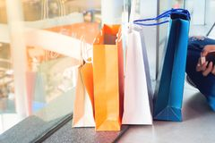 Close up of shopping bags on floor in department store, Lifestyl Stock Image