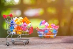 Close up of shopping cart full of legos