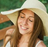 Close up shor of cheerful young woman with closed Stock Photos