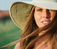 Close up shor of cheerful young woman with closed Stock Photography