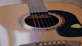 Acoustic guitar on the stage. Close up shot of acoustic guitar on the stage stock footage