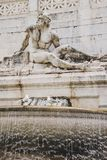 Close-up shot of ancient fountains statue element with male figure sculpture,. Rome, Italy Stock Photography