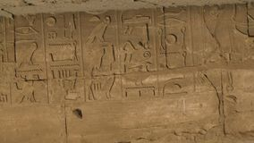 Hieroglyphics panning shot close up. Close up shot of ancient  hieroglyphics stock video footage