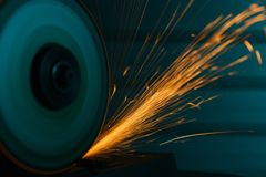Close-up shot of an angle grinder with sparkles Stock Image