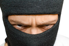 Close-up shot of angry man in black mask Stock Photos
