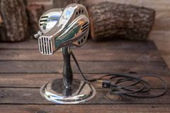 Close up shot of a antique 1950s hair dryer, vintage concept. Close up shot of a antique 1950s hair dryer, vintage retro style concept royalty free stock photography