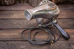 Close up shot of a antique 1950s hair dryer, vintage concept. Close up shot of a antique 1950s hair dryer, vintage retro style concept stock photography