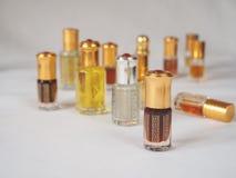 Close up shot of arabian oud oil made of agar wood in a beautiful glass jar. Royalty Free Stock Image