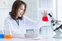 Scientist records experiment results stock images