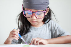 Close up shot of Asian little girl painting color shallow dept o. F field stock image