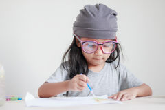 Close up shot of Asian little girl painting color shallow dept o. F field royalty free stock photos