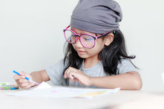Close up shot of Asian little girl painting color shallow dept o. F field royalty free stock image