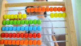 Close up shot asian little girl playing abacus with mother