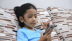 Close up shot of asian little girl using smartphone at home stock footage