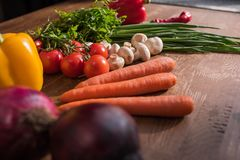 Close-up shot of assorted fresh vegetables. On rustic table Royalty Free Stock Photos