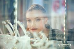 Close up shot of attractive young woman out shopping for jewelry Stock Photography