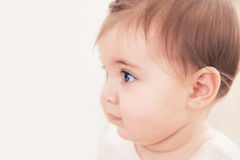 Close up shot of baby girl with blue eyes. Stock Image