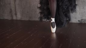 Close up shot of the elegant ballerina`s legs, the lady is standing on her socks stock video