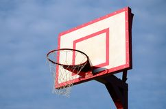 Close-up shot of a basketball ring on a background of a cloudy blue sky stock images