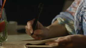 Close-up shot of beautiful lady writing romantic memories in diary, vacation. Stock footage stock video footage