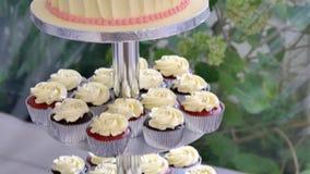 Close up shot of a beautiful wedding cup cake. A Close up shot of a beautiful wedding cup cake stock video