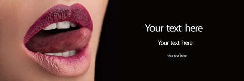 Close-up shot of beautiful woman lips, girl licking her lips. Conceptual image Stock Images