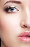 Close-up shot of beautiful young woman face with day  make up Royalty Free Stock Photo